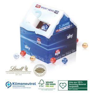3D Adventskalender Weihnachtshaus mit Lindt Lindor Kugeln gefüllt und individuell bedruckt als Werbeartikel.