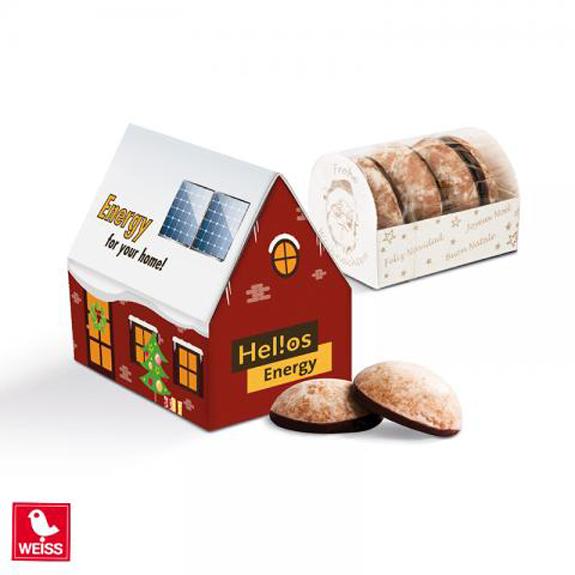 Das Lebkuchenhaus ist in 3D und aus Karton. Das Lebkuchenhaus ist gefüllt mit 4 Mini-Lebkuchen der Marke WEISS. Das Lebkuchenhaus kann individuell bedruckt werden nach Wunsch.