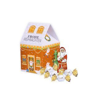 3D Präsent Weihnachtshaus individuell bedruckt und gefüllt mit Lindt Vollmilchkugeln als Werbeartikel.