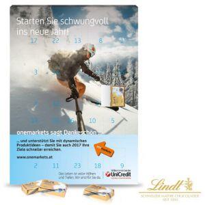 """Der Adventskalender """"Lindt"""" ist ein Tisch- oder Wandkalender. Der Kalender kann individuell bedruckt werden auf der Vorder- und Rückseite und Türchen-Innenseiten. Gefüllt ist der Kalender mit Lindt-Täfelchen."""