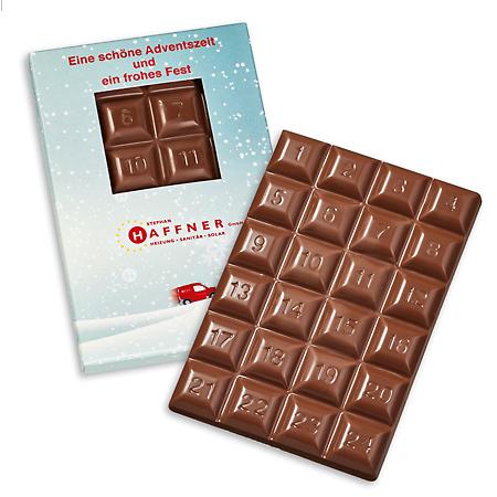 Adventsschokolade mit Schokoladenstückchen 1-24 verpackt in einer Werbebox aus Karton mit individuellem Druck als Werbeartikel.