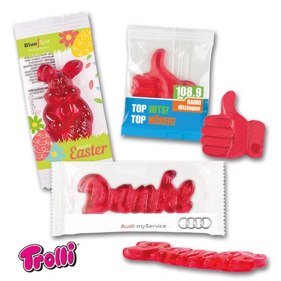 Fruchtgummi in Standardform maxi in verschiedenen Ausführungen. Verpackt zu 1 Stück in transparenten Folie mit Werbedruck.
