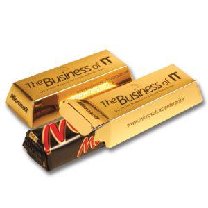 Die Goldbarren Box Mars ist gefüllt mit einem Mars-Riegel. Die Goldbarren Box kann individuell geprägt oder individuell bedruckt werden.