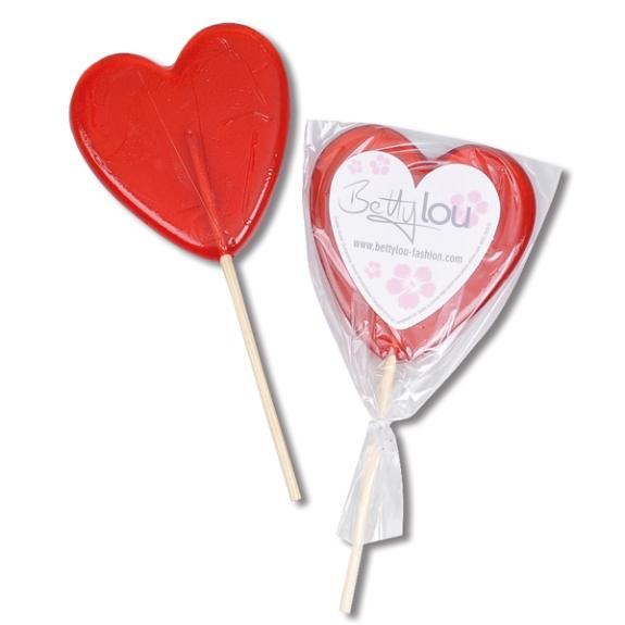 Herz Lolly mit Etikett mit individuellem Druck nach Wunsch. Das Etikett kann mit einem Logodruck versehen werden. Die Farben der Herz Lollies können nach Wunsch gewählt werden.