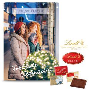Der Jubiläum Adventskalender kann individuell bedruckt werden auf allen Seiten, auch auf den Türchen-Innenseiten. Lindt Täfelchen mit 3 Geschmackssorten.