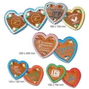 Lebkuchen Herzen mit individuellem Siebdruck aus Zuckerguß. Verschiedene Größen der Lebkuchen Herzen sind möglich. Siebdruck nur in weiß oder einfarbig.