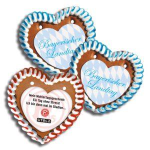 Lebkuchen Herzen mit individuell bedrucktem Herz-Papieraufleger. Die Lebkuchen Herzen gibt es in verschiedenen Größen.