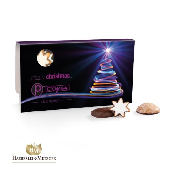 Die Lebkuchenmischung im Werbeschuber ist aus 8 verschiedenen weihnachtlichen Gebäcksorten. Der Werbeschuber kann individuell bedruckt werden. Die Lebkuchen sind von der Marke Haeberlein Metzger.