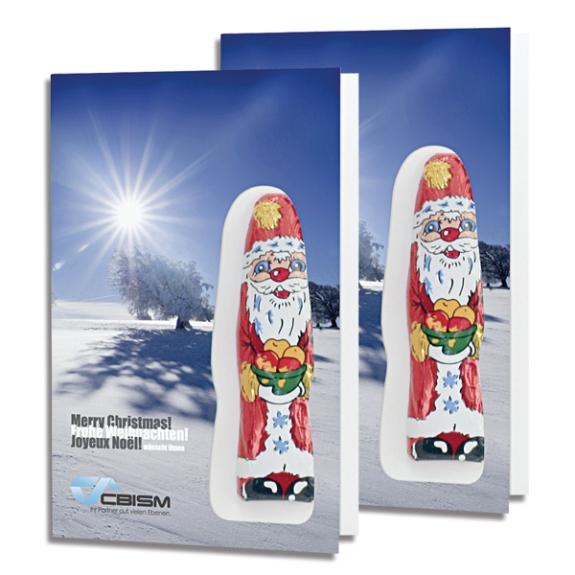 Die Nikolaus Faltkarte kann auf der Vorderseite, der Rückseite und beiden Innenseiten individuell bedruckt werden. Auf der Karte ist ein Schoko-Nikolaus aufgeklebt.