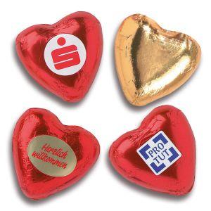 Schoko Herzen in roter Folie mit Werbeetikett individuell bedruckt.