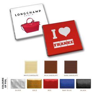 Schoko Täfelchen mit Banderole 5g mit individuellem Druck. Vollmilch-, Weiße oder Zartbitterschokolade. Verschiedene Farben des Alupapiers sind möglich.