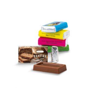 Die Schoko Täfelchen Napolitains 3g mit Werbedruck auf der Banderole. Kleine Schokoladentäfelchen aus Vollmilchschokolade mit Ihrem Logo bedruckt.