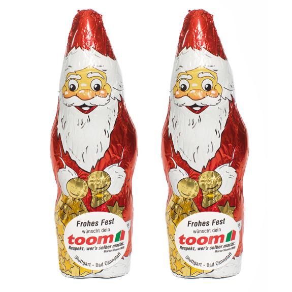 Der Schoko Weihnachtsmann ist aus deutscher Fairtrade Markenschokolade. Das Werbeetikett kann individuell bedruckt werden.