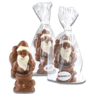 Schoko Wehnachtsmann in Tüte 50g im transparenten Beutel mit Werbeetikett. Das Etikett wird individuell bedruckt nach Wunsch.