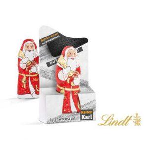 Der Schoko Weihnachtsmann Lindt 10g ist in einem Werbeaufsteller verpackt. Der Werbeaufsteller kann individuell bedruckt werden nach Wunsch.