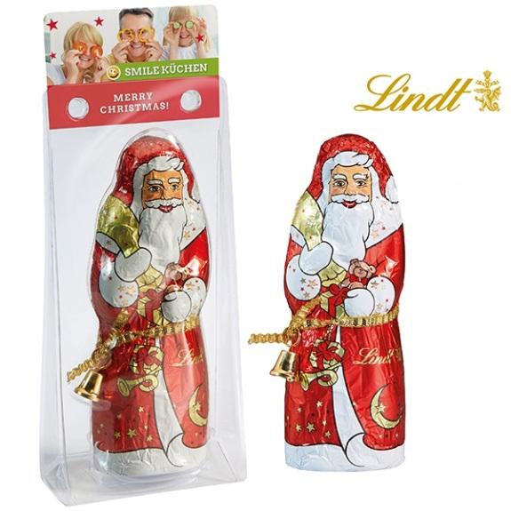 Der Weihnachtsmann Lindt ist 70g und verpackt in einem transparenten Blister mit einem Werbekärtchen. Das Kärtchen wird individuell bedruckt.