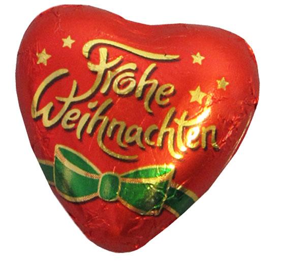 """Schokoherz mit Standardaufdruck """"Frohe Weihnachten"""". Einzeln in Stanniolfolie verpackt."""