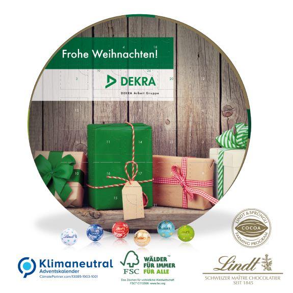 Adventskalender rund individuell bedruckt nach Wunsch als Werbeartikel und gefüllt mit Lindt Lindor Kugeln.