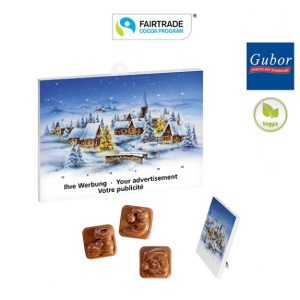 Der Tischkalender mit Standardmotiv kann individuell mit Werbeeindruck zum Beispiel Logo und Text bedruckt werden. Gefüllt ist der Kalender mit Fairtrade Vollmilchschokolade der Marke Gubor.