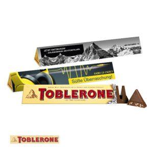 Toblerone im Werbeschuber 100g mit individuell bedruckter Banderole aus Karton.