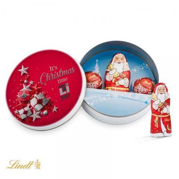 Die Weihnachtsdose ist gefüllt mit 1 Lindt Weihnachtsmann 10g und 2 Lindor-Kugeln. Die Weihnachtsdose kann individuell bedruckt werden auf dem Deckel.Schokolade