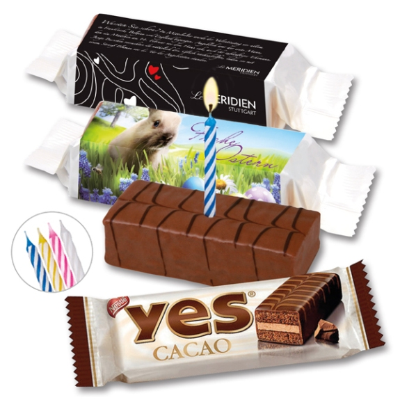 Das Yes Törtchen mit Banderole kann individuell bedruckt werden auf der Banderole. Oder Sie wählen ein Standardmotiv und drucken Ihr Logo mit Text darauf. Eine Mini Kerze kann alternativ dazu bestellt werden.