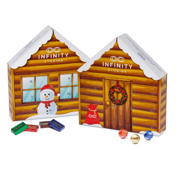 Adventskalender Weihnachtshaus mit Lindt Schokolade und individuell bedruckt als Werbegeschenk.