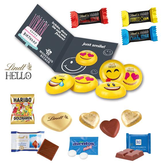 Die Werbe Klappkarte ist gefüllt mit Lindt Herzen, Lindt Täfelchen, Ritter Sport Täfelchen, Lindt Hello Emoties oder Haribo Tütchen mit Goldbären. Das Tütchen kann individuell bedruckt werden.