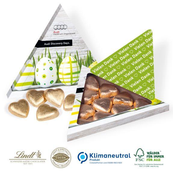 Lindt Pyramiden Präsentverpackung mit Lindt Herzen individuell bedruckt als Werbeartikel.