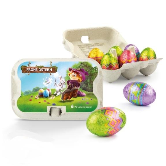 Ostereier Sixpack mit Werbeetikett ist gefüllt mit sechs Ostereiern aus Vollmilchschokolade der Marke Klett.