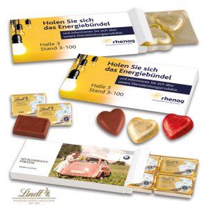 Die Präsentverpackung von Lindt ist gefüllt mit 5 Schokoladenherzen von Lindt oder 6 Schokotäfelchen von Lindt. Die Präsentbox kann individuell bedruckt werden.