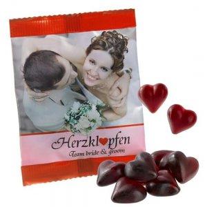Cassis Fruchtgummi Herzen in Werbetüte individuell bedruckt. Fruchtgummi Herzen als Werbeartikel in Tüte mit Logo Aufdruck. Werbeartikel Fruchtgummi Herzen mit Aufdruck.