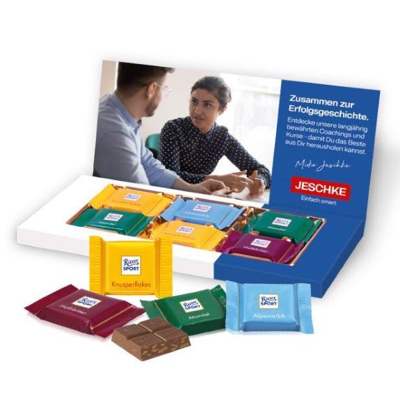 6 Stück Ritter Sport Täfelchen in Präsentbox mit Logo bedruckt als Werbeartikel.