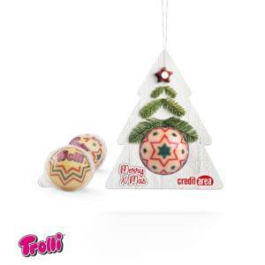 Fruchtgummi-Kugel mit Apfel-Zimtfüllung. Einzeln verpackt in einer transparenten Plastikugel. Die Werbekarte in Tannenbaumform wird individuell bedruckt.