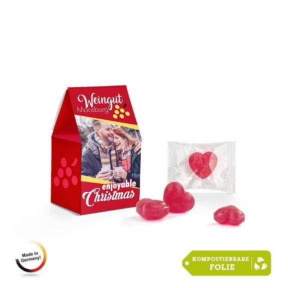 Glühweinbonbons in Herzform sind einzeln verpackt in kompostierbarer Folie. 6 Glühweinbonbons sind verpackt in einer Standbodenbox. Die Box kann individuell bedruckt werden.