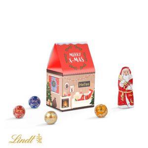 Weihnachtshaus aus Karton als Standbodenbox gefüllt mit einer Lindt-Mischung. Das Weihnachtshaus kann individuell nach Wunsch bedruckt werden.