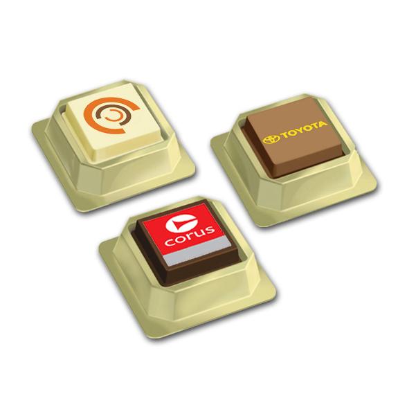 Praline mit Logo oder mit Foto bedruckt, eimzeln verpackt in Goldbox mit transparentem Deckel..