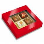 Pralinen mit Logo bedruckt direkt auf der Schokolade, verpackt zu 4 Stück in einer Geschenkbox mit Sichtfenster.