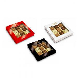 Pralinen mit Logo bedruckt direkt auf der Schokolade verpackt zu 9 Stück in einer Geschenkverpackung mit Sichtfenster.