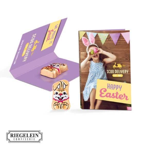 Die Werbekarte Osterhase ist eine Klappkarte mit Abreißperforation und einem Schoko-Osterhasen, die individuell bedruckt wird.