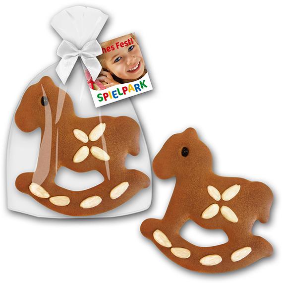 werbemittel weihnachten schaukelpferd mit mandeln und werbekarte